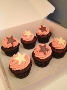 Chocolate cupcakes with pink vanilla buttercream and giant chocolate stars